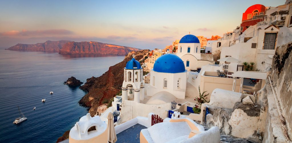 White houses and blue domes of the churches dominate the Aegean Sea Oia Santorini Cyclades Greece Europe
